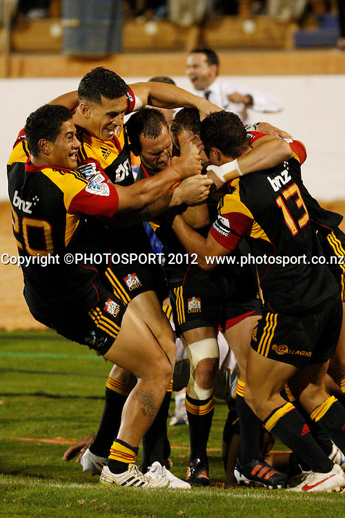 A happy chiefs team after there extra time win their game at Baypark Stadium, Mt Maunganui, New Zealand. Friday,16 March 2012. Photo: Dion Mellow/photosport.co.nz