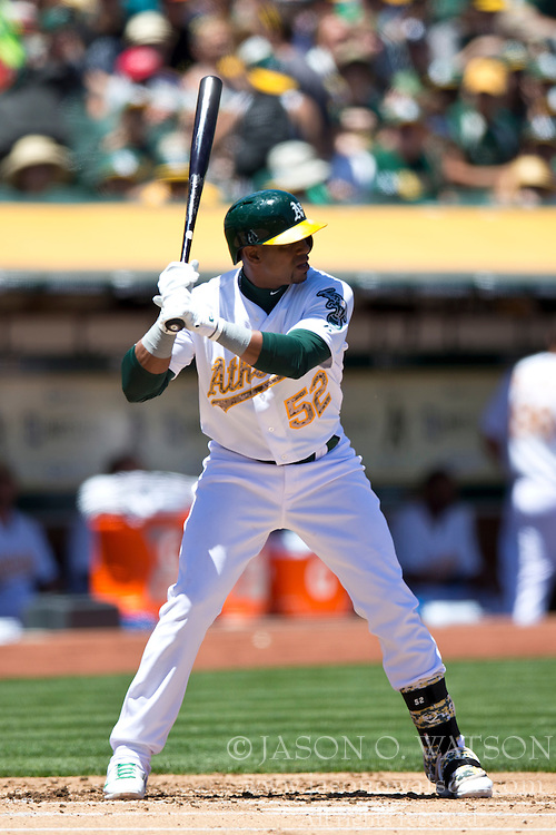 OAKLAND, CA - MAY 26:  Yoenis Cespedes #52 of the Oakland Athletics at bat against the Detroit Tigers during the first inning at O.co Coliseum on May 26, 2014 in Oakland, California. The Oakland Athletics defeated the Detroit Tigers 10-0.  (Photo by Jason O. Watson/Getty Images) *** Local Caption *** Yoenis Cespedes