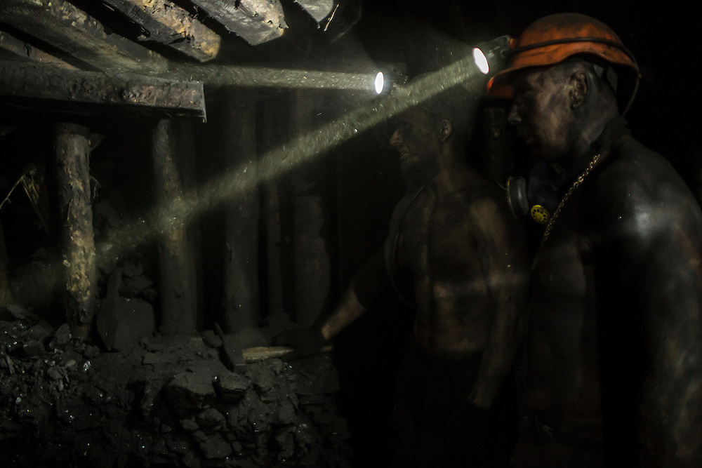 Miners work at the coal face 1300 meters underground at the Shcheglovskaya Coal Mine on Friday, March 25, 2016 in Makiivka, Ukraine.