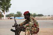 An SPLA soldier guards Customs Road, where Garang Masoleum is currently being spruced up for South Sudanese independence ceremonies on July 9th.