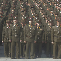 Soldiers of the Korean People's Army prepare to pay their respects at the Revolutionary Martyrs' Cemetery in Pyongyang, on April 15 2012. This day marked the 100th birthday of Kim Il Sung, the founder of the Democratic People's Republic of Korea (DPRK). A military parade and a speech by current leader Kim Jung-Un - his first public address - were part of the massive celebrations.