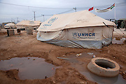 Puddles of water surround tents at  the Za'atri Syrian refugee camp in northern Jordan February 5,2013. ..Jordan announced on Tuesday that the number of Syrian refugees in the country is expected to exceed 700, 000 in 2013, the state-run Petra news agency reported. (Photo by Heidi Levine/Sipa Press).