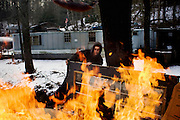 Tylor Woodrum, 16, burns trash in the backyard of his step-mom's house in Carbondale, OH. His father, Dave Woodrum, was killed in August of 2006 in a high-impact 4-wheeler accident. Dave's family had his body cremated and his favorite cock-fighting rooster mounted on top of the box.