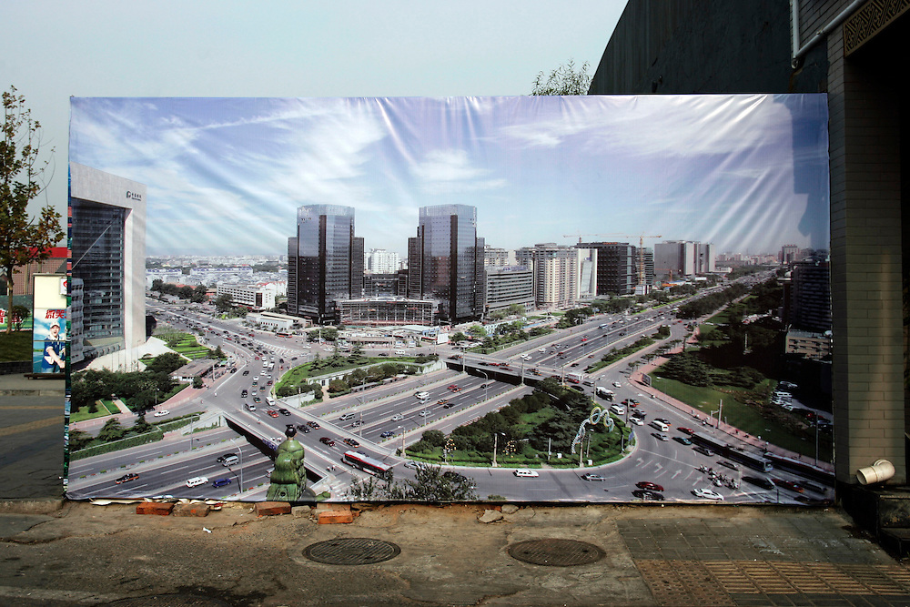 A poster showing the projected view of an urban development on display at the site where investors plan to build it Beijing, China, Tuesday, Nov. 11, 2008. Block after city block, towers of concrete, steel and glass fill the skyline Teeming and congested, the intensely urban landscapes of China's biggest cities show a glimpse of what the future will hold for the rest of the country.In the sprawling megacities of Beijing, Shanghai and Chongqing, where populations exceed 10 million people, extreme urban density means that the number of people living within a few square blocks here is equal to the population of entire mid-size U.S. cities. .China's urban population soared to 607 million people last year _ nearly equaling the 700 million living in the countryside. The country's headlong plunge toward urbanization continues unabated as tens of millions of migrants from the countryside flood to cities in search of money, jobs and other opportunities.