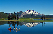 Father and children in canoe, Sparks Lake and South Sister, Cascade Mountains, Oregon.
