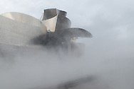 Guggenheim museum, Bilbao, Spain. Designed by American architect Frank Gehry. Mist designed by Fujiko Nakaya.