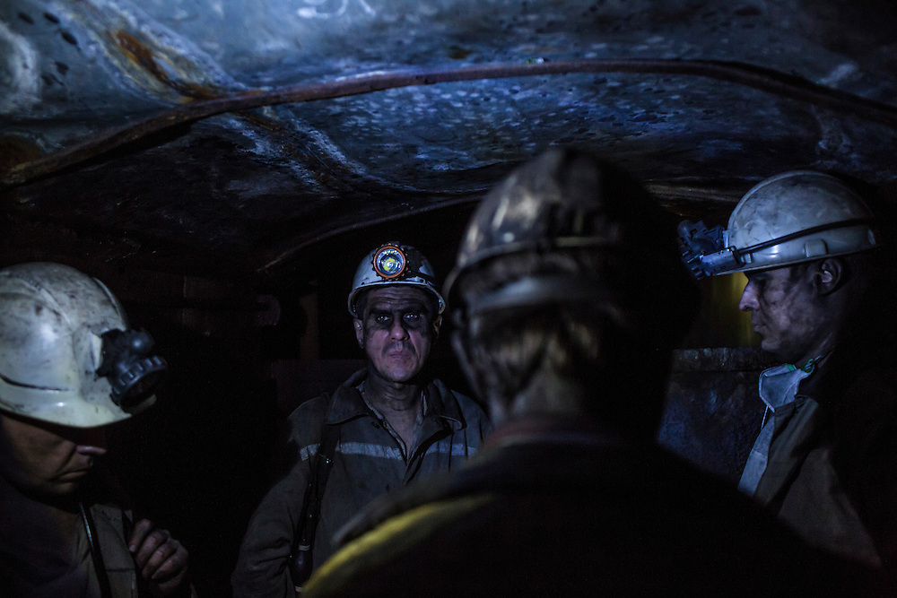 Miners ride the elevator up to the surface at the Shcheglovskaya Coal Mine on Friday, March 25, 2016 in Makiivka, Ukraine.
