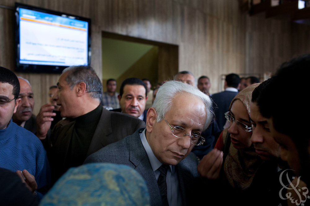 A top editor, Abdul Azeem Darwish(c) tries to calm a group of protesters February 09, 2011 in the lobby of Al Ahram, the country's semi-official newspaper in downtown Cairo, Egypt. The protesters, part-time employees at the paper were critical of the paper's recent anti-democracy movement coverage and were also hoping to gain concessions that would elevate them to full-time workers.   (Photo by Scott Nelson)..Credit: Scott Nelson for the New York Times