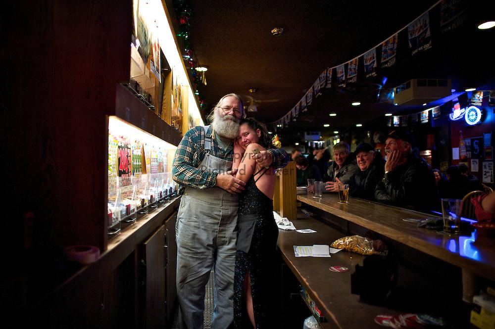 2010 December 31 - New Years eve at Poggie Tavern West Seattle, WA, USA. Bartender Jim and other unidentified bartender. CREDIT: Richard Walker