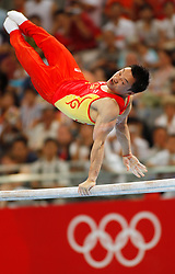 China's Yang Wei competes on the parallel bars for the artistic gymnastics men's team during the Olympic games in Beijing, China, 12 August 2008. The Chinese won the gold medal for the event with Japan and United States taking silver and bronze respectively.