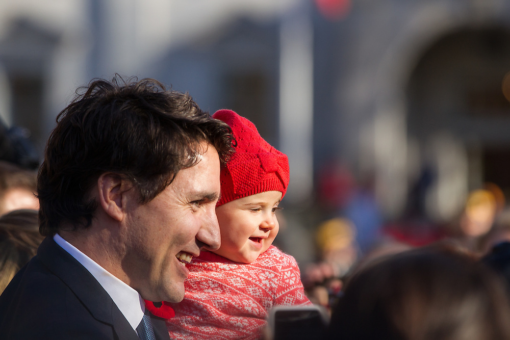 Prime Minister Justin Trudeau holds a baby as he greets the crowd outside Rideau Hall after being sworn in as Canada's 23rd Prime Minister in Ottawa, Ontario, November 4, 2015.<br />
