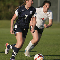 Cape Fear's Addie Lalia advices the ball past Coastal Christian's Lilian Quinn. (Jason A. Frizzelle)