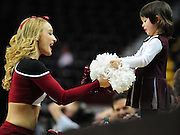New Mexico State cheerleader Cassidy Jonelle-Harrison interacts with a young fan during a timeout.