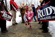 Emily Wendelboe, age 4 from New Hampton, NH, holds a sign outside after a campaign rally by Rudy Giuliani in Plymouth, NH, on Sunday, Dec. 30, 2007.