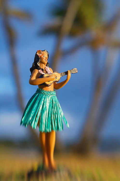 Hula doll and palm trees; Hawaii.