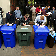 Contestants fill out questionnaires while waiting their chance as ESPN stages a one-day audition for a spot on its sports network show. Hundreds lined up outside of McFaddens Pub and in time had to take a sports quiz, group interview and a few selected for taped interviews...