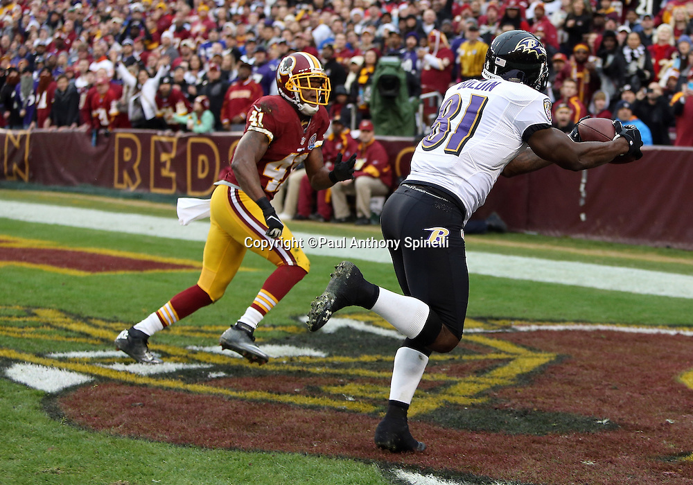 Baltimore Ravens wide receiver Anquan Boldin (81) catches a first quarter touchdown pass that ties the score at 7-7 while covered by Washington Redskins free safety Madieu Williams (41) during the NFL week 14 football game against the Washington Redskins on Sunday, Dec. 9, 2012 in Landover, Md. The Redskins won the game in overtime 31-28. ©Paul Anthony Spinelli