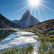 In Zermatt, Switzerland, the Gornergrat rack railway (GGB) takes you to a spectacular ridge (at 3135 m or 10,285 ft) between Gornergletscher and Findelgletscher, with views of 20+ four-thousand meter peaks, whose highest are Dufourspitze (Monte Rosa massif), Liskamm, Matterhorn, Dom and Weisshorn. Gornergrat train, opened in 1898, climbs almost 1500 m or 4900 ft via Riffelalp and Riffelberg in the Pennine Alps, Europe.