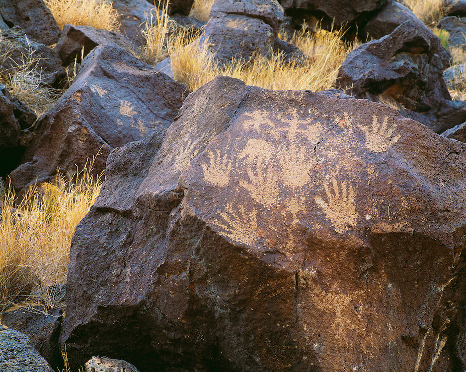 0211-1008 ~ Copyright:  George H. H. Huey ~ Human hand print style petroglyphs.  @ A.D. 1300-1650.  Piedras Marcadas Unit.  Petroglyph National Monument, New Mexico.