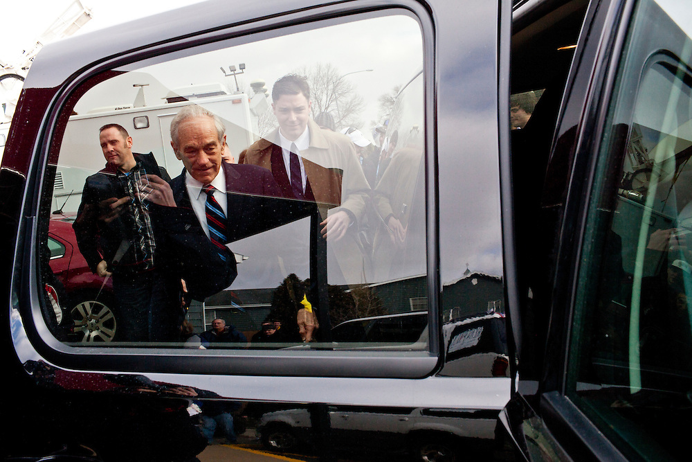 Republican presidential candidate Ron Paul leaves after a campaign rally at the SteepleGate Inn on Monday, January 2, 2012 in Davenport, IA.