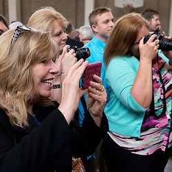 4 JUNE 2016 -- ST. LOUIS -- Sheila Trani (left) joins other in photographing newly-installed Deacons during a reception in Boland Hall following the Ordination of Deacons at the Cathedral Basilica of St. Louis Saturday, June 4, 2016 in St. Louis. Eighteen men from across the Archdiocese were ordained.<br /> <br /> Photo by Sid Hastings.
