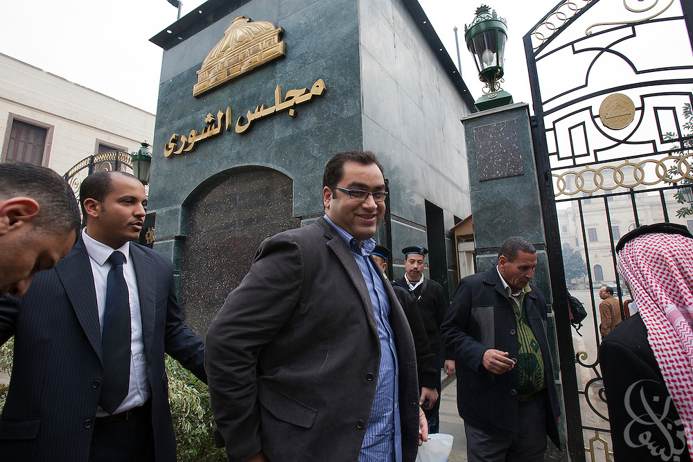 Egyptian Parliamentarian-elect Zyad Elelaimy enters the the parliament complex on his way to the historic first session of Egypt's newly elected Parliament session Jan 23, 2012 in Cairo, Egypt.
