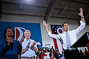 Republican vice presidential candidate Rep. Paul Ryan greats the crowd with Condoleeza Rice, left, and Senator Rob Portman, center, at a campaign rally at Baldwin Wallace University in Berea, Ohio, October 17, 2012.