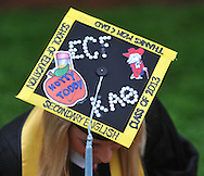 Graduate Emily Clinard of Memphis, Tenn.  decorated her mortar board for the University of Mississippi graduation ceremony in Oxford, Miss. on Saturday, May 11, 2013. (AP Photo/Oxford Eagle, Bruce Newman)