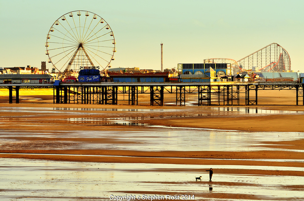 Blackpool beach looking towards Central Pier at low tide. Blackpool is a famous holiday resort in Lancashire, England.