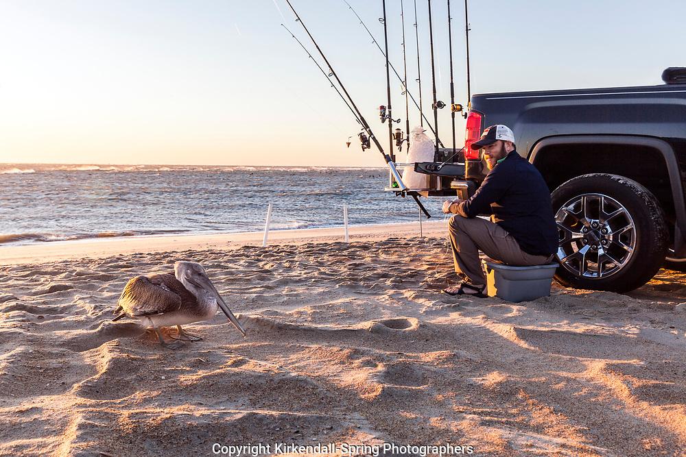 NC00842-00...NORTH CAROLINA - Surf fishing at Cape Hatteras in Cape Hatteras National Seashore.