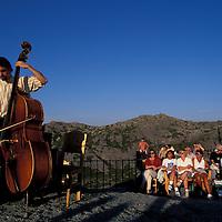 Europe, Norway. Sunset musical concert atop Mount Ulriken overlooking Bergen