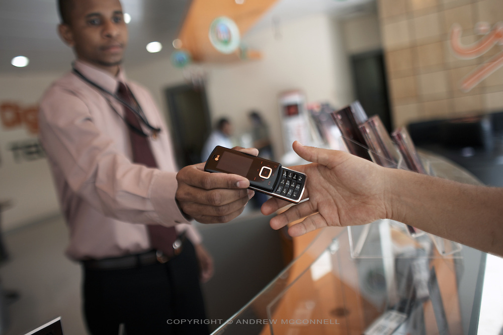 Customers browse for mobile phones in LG's Digitech showroom in central Khartoum, Sudan..Khartoum is modeling itself as the Dubai of Africa and despite Western sanctions the city is booming. Away from the troubles and poverty that plaque the rest of Sudan, development in Khartoum is moving at an astonishing rate. Investment from the East, and in particular China, allowed the Sudanese economy to grow by 11% in 2007. This growth is driven largely by oil, with production rising from 63,000 barrels per day in 1999 to over 500,000 barrels today.