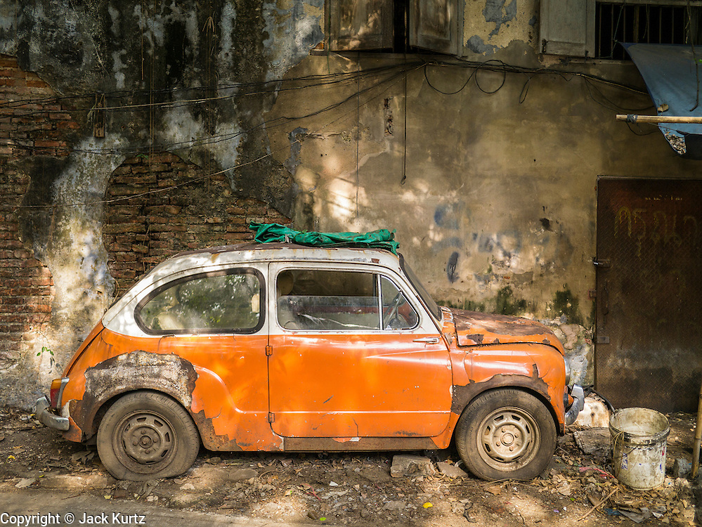 20 APRIL 2013 - BANGKOK, THAILAND:   A broken down, inoperable old Fiat 500 in Talat Noi (Talat means Market, Noi means Small. Literally Small Market). The Talat Noi neighborhood in Bangkok started as a blacksmith's quarter. As cars and buses replaced horse and buggy, the blacksmiths became mechanics and now the area is lined with car mechanics' shops. It is one the last neighborhoods in Bangkok that still has some original shophouses and pre World War II architecture. It is also home to a  Teo Chew Chinese emigrant community.   PHOTO BY JACK KURTZ