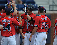 Mississippi's Matt Snyder (33) hits a solo home run vs. St. John's during an NCAA Regional game at Davenport Field in Charlottesville, Va. on Sunday, June 6, 2010.