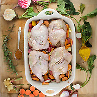 Erin's ginger, shallot, apricot glazed cornish hens moments before they went into the oven with some of the vegetables that were roasted along side it.