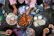 Breakfast in a Ho Chi Minh CIty alleyway consists of stewed pig intestines and stomach. Vietnam