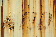 """The word """"and"""" in rust and chipped paint on a train car"""