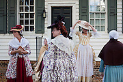 Williamsburg, VA - October 5, 2010: Amaree Cluff, Savannah Mitchell, Sharon Hollands, and Kate Kovach prepare for a scene in Colonial Williamsburg, Virginia on Tuesday, October 5, 2010 where they work as actor-interpretors.<br /> <br /> (Photo by Matt Eich/LUCEO for The Washington Post)