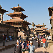 "Visitors stroll in Patan's Durbar Square, in Nepal, Asia. Patan was probably founded by King Veer Deva in 299 AD from a much older settlement. Patan, officially called Lalitpur, the oldest city in the Kathmandu Valley, is separated from Kathmandu and Bhaktapur by rivers. Patan (population 190,000 in 2006) is the fourth largest city of Nepal, after Kathmandu, Biratnagar and Pokhara. The Newar people, the earliest known natives of the Kathmandu Valley, call Patan by the name ""Yala""  (from King Yalamber) in their Nepal Bhasa language. UNESCO honored Patan's Durbar Square (Palace Square) as one of the seven monument zones of Kathmandu Valley on their World Heritage List in 1979. All sites are protected under Nepal's Monuments Preservation Act of 1956. Published in ""Light Travel: Photography on the Go"" book by Tom Dempsey 2009, 2010."