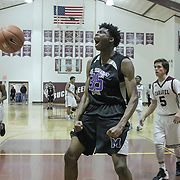 St. Thomas More Center Elias Revelle (35) celebrates after dunking the ball during a regular season high school basketball game between Caravel Academy and St. Thomas More Sat. Jan. 14, 2016 at Caravel Academy in Bear.