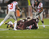Ole Miss' Cody Prewitt (25) intercepts a pass vs. Mississippi State wide receiver Chris Smith (8) and Mississippi State wide receiver Malcolm Johnson (80)  in Starkville, Miss. on Saturday, November 26, 2011.