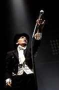 READING, ENGLAND - AUGUST 24:  Pelle Almqvist of The Hives performs live on the NME Radio 1 Stage during Day One of Reading Festival 2012 at Richfield Avenue on August 24, 2012 in Reading, England.  (Photo by Simone Joyner/WireImage)