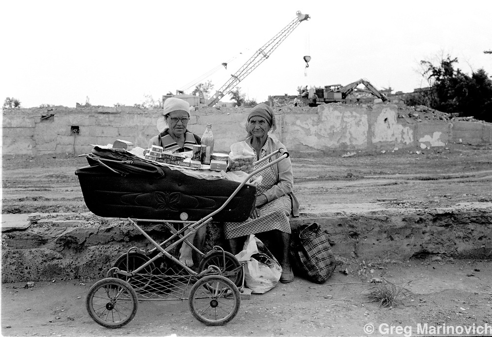 IPMG0836 Grozny, Chechnya, 1995: Women sell cigarettes and supplies from a pram in the devestated capital of Chechnya, Grozny, July 1995.  Russian bombing left very few buildings in the centre itact during a bloody war. Russia agreed to grant autonomy after Chechens retook several towns and the capital Grozny in 1995, after a bloody war for Chechen independence.  The Chechens are Moslem and have a strong sense of national identity.  Their fight for independence from Russia has increased an Islamic militancy and  identity. <br /> Photograph by Greg Marinovich/South Photographs