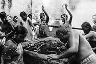 Alagar Koyil, India: Bathers at Noopura Gangai in the Pazhamudircholai temple north of Madurai.