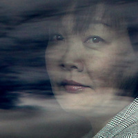 (Boston, MA - 4/26/15) Akie Abe, wife of Japanese Prime Minister Shinzo Abe, is seen through reflections on the window of her limosine as she and her husband depart Logan International Airport, Sunday, April 26, 2015. Staff photo by Angela Rowlings.