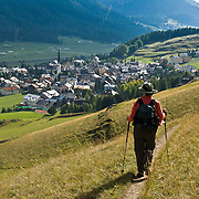 """In Upper Engadine, walk to Zuoz village in Graubünden canton, Switzerland, the Alps, Europe. The Swiss valley of Engadine translates as the """"garden of the En (or Inn) River"""" (Engadin in German, Engiadina in Romansh, Engadina in Italian). Published in Wilderness Travel Catalog of Adventures 2014. For licensing options, please inquire."""