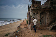 Attempts to slow the advance of the Bay of Bengal, even after the 2004 Asian Tsunami damaged this house, seemed to have had little success in this northern part of Pondicherry.  Southern India.