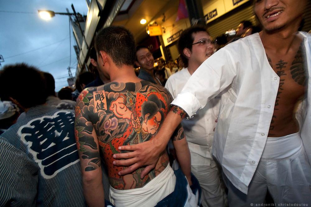Displaying a full body tattoo by a yakuza during the Sanja matsuri (festival) in Asakusa, Tokyo
