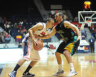 "Ole Miss' Marshall Henderson (22) vs. Coastal Carolina's Anthony Raffa (2) at the C.M. ""Tad"" Smith Coliseum in Oxford, Miss. on Tuesday, November 13, 2012. (AP Photo/Oxford Eagle, Bruce Newman)"