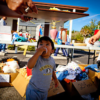 PLANT CITY, FL -- While their mother works all day, Raymond Lopez, 1, eats a cupcakes as he shops with his grandma during a yard sale for needy families at Cultural Service Center in Plant City, Fla., on Saturday, January 27, 2012. As the Florida Primary approaches, the voters along the I-4 corridor are becoming an increasingly more important path to securing a win.  (Chip Litherland for The New York Times)